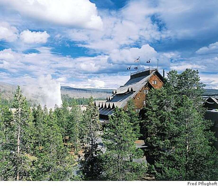 """At Yellowstone's Old Faithful Inn in Wyoming, book early to get a room with a geyser view. Illustrates TRAVEL-LODGES (category t), by Steve Hendrix (c) 2004, The Washington Post. Moved Tuesday, June 1, 2004. (MUST CREDIT: Photo by Fred Pflughoft, from """"Great Lodges of the National Parks,"""" by Christine Barnes (W.W. West) Photo: Fred Pflughoft"""