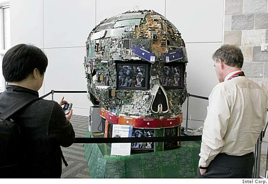 Showgoers at the Intel Developer's Forum regard this 9-foot skull fashioned from recycled electronic components by James Burgett, founder of the Alameda County Computer Resource Center. Photo courtesy of Intel Corp. Photo: Intel Corp.