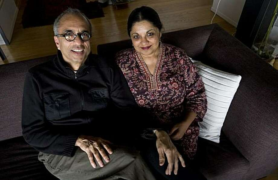 Sudhish Mohindroo and Kavita Shridharani, from left, pose for a portrait on their couch in Berkeley, Calif. on Friday, Feb. 5, 2010.  The two met on an arranged date, but turned out to have more than they expected in common. Photo: Adam Lau, The Chronicle
