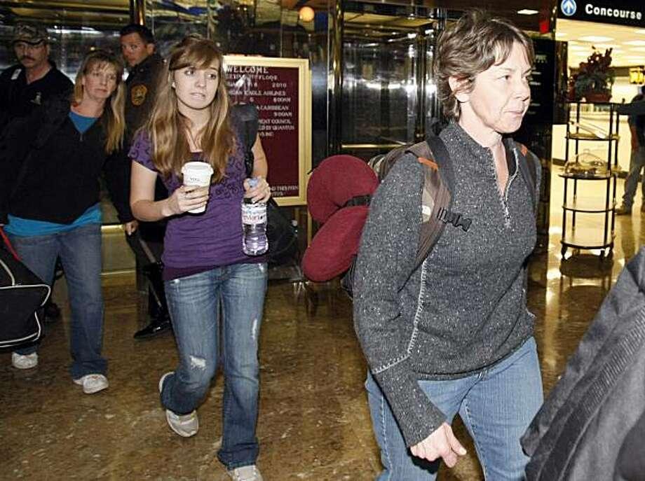 From right, Carla Thompson, 53, of Meridian, Idaho, Nicole Lankford, 18, of Middleton, Idaho, and Corinna Lankford, of Meridian, Idaho, leave the Miami International Airport Hotel in Miami, Thursday, Feb 18, 2010. Photo: Alan Diaz, AP