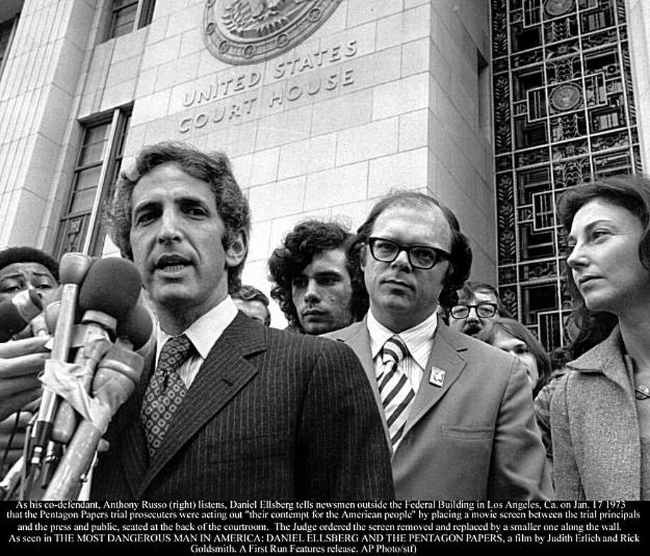 "As his co-defendant, Anthony Russo (right) listens, Daniel Ellsberg tells newsmen outside the Federal Building in Los Angeles, Ca. on Jan. 17 1973 that the Pentagon Papers trial prosecuters were acting out ""their contempt for the American people"" by placing a movie screen between the trial principals and the press and public, seated at the back of the courtroom.  The Judge ordered the screen removed and replaced by a smaller one along the wall.   As seen in THE MOST DANGEROUS MAN IN AMERICA: DANIEL ELLSBERG AND THE PENTAGON PAPERS, a film by Judith Erlich and Rick Goldsmith. A First Run Features release. Photo courtesy Daniel and Patricia Ellsberg. Photo: AP"