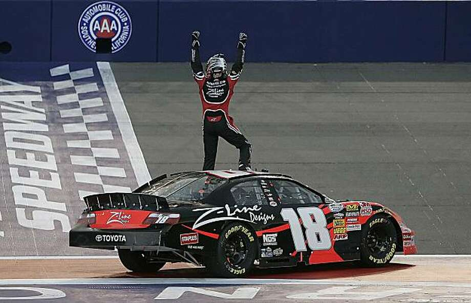 NASCAR driver Kyle Busch (18)  raises his arms in celebration after winning the Nationwide Stater Bros. 300 auto race at Auto Club Speedway in Fontana, Calif., Saturday, Feb. 20, 2010. Photo: Alex Gallardo, AP
