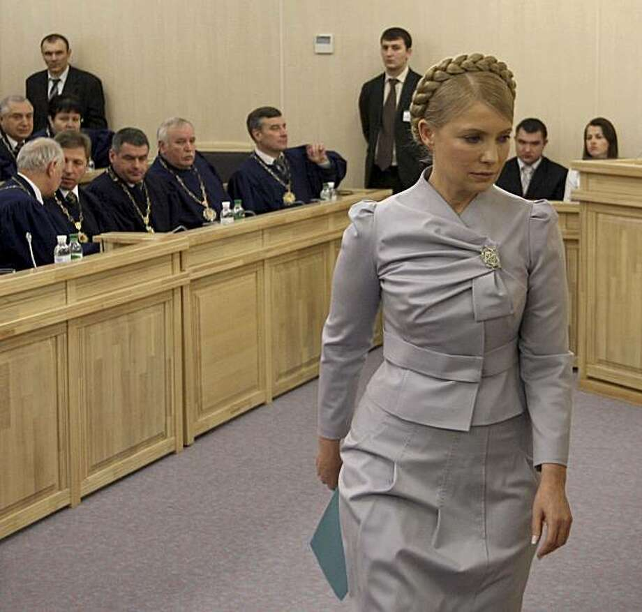 Ukrainian Prime Minister Yulia Tymoshenko leaves the Ukraine's Administrative Court in  Kiev, Ukraine, Saturday, Feb. 20, 2010. She demanded the withdrawal of her appeal of the results of the Feb. 7 presidential election that she lost by a narrow margin. Photo: Aleksandr Prokopenko, AP