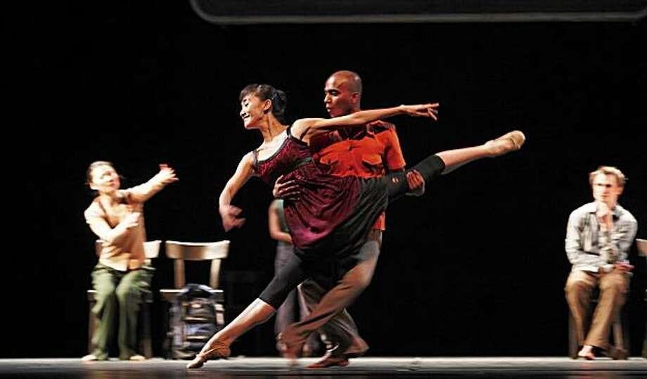 Members of the  Akram Khan Company  perform - - bahok- credit Liu Yang Saju with one of the original National Ballet of China dancers, Meng Ning Ning Photo: Liu Yang