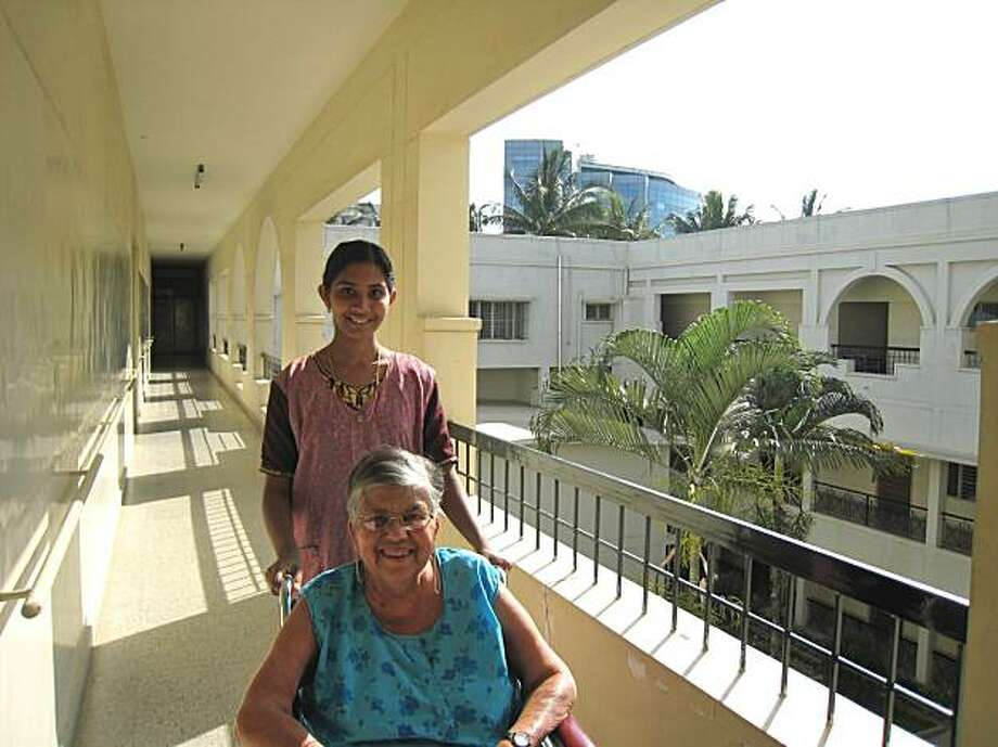 Betty Kamath and her attendant in Bangalore, India. Cletas Home - The old age home in Bangalore is run by nuns. There is a wait list to get in. With fewer nuns around, one of the novice quarters is being converted into an old age home as well. Photo: Adrian D'Souza