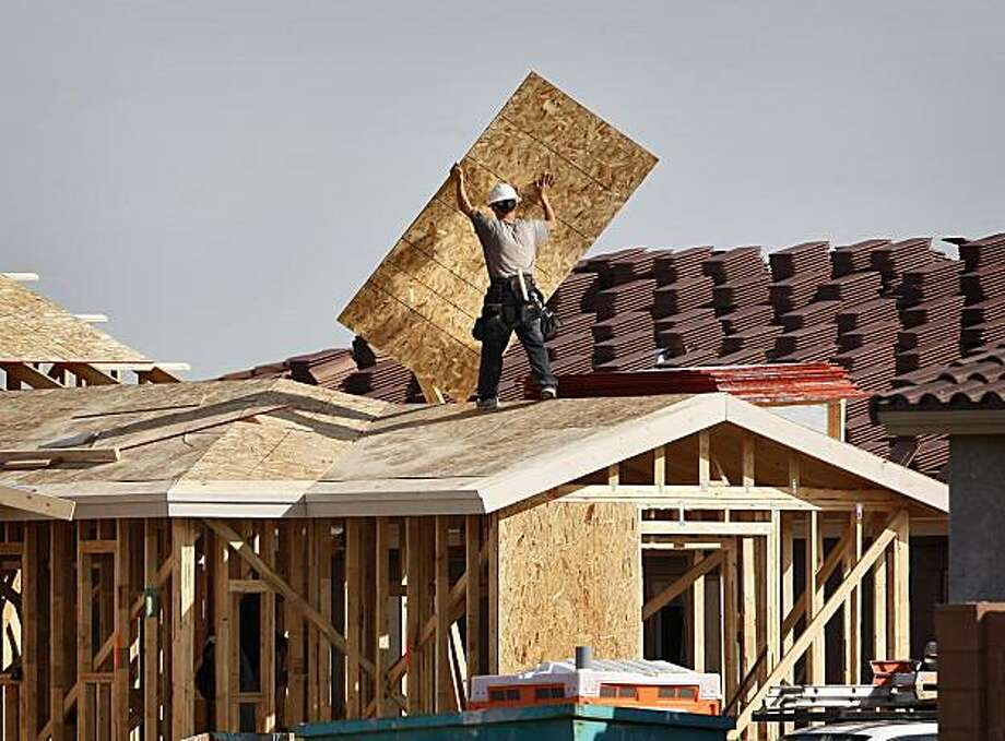 In this photo made Feb. 4, 2010, a new home is under construction in Gilbert, Ariz. Construction of new homes and apartments posts better-than-expected January rebound. Photo: Matt York, AP