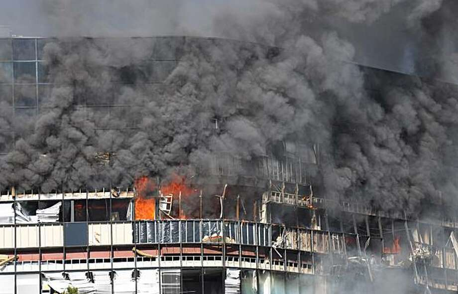 In this photo provided by Trey Jones, smoke billows from a seven-story building  in Austin, Texas after a small private plane crashed into it Thursday Feb. 18, 2010. (AP Photo/Trey Jones) NO SALES  MANDATORY CREDIT Photo: Trey Jones, AP