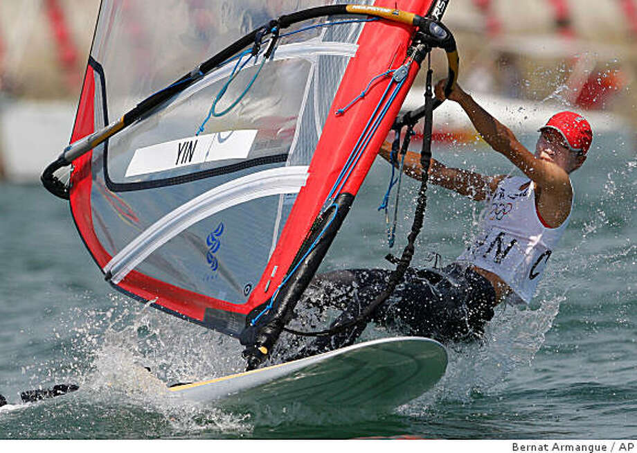 Chinese windsurfer Yin Jian competes before winning the gold medal of the RS-X Women sailing class competition of the 2008 Beijing Olympics in Qingdao, about 720 kilometers southeast of Beijing, Wednesday, Aug. 20, 2008. Yin Jian won the host nation's first-ever Olympic sailing gold medal. Italy's Alessandra Sensini won the silver and Britain's Bryony Shaw scored bronze. (AP Photo/Bernat Armangue) Photo: Bernat Armangue, AP