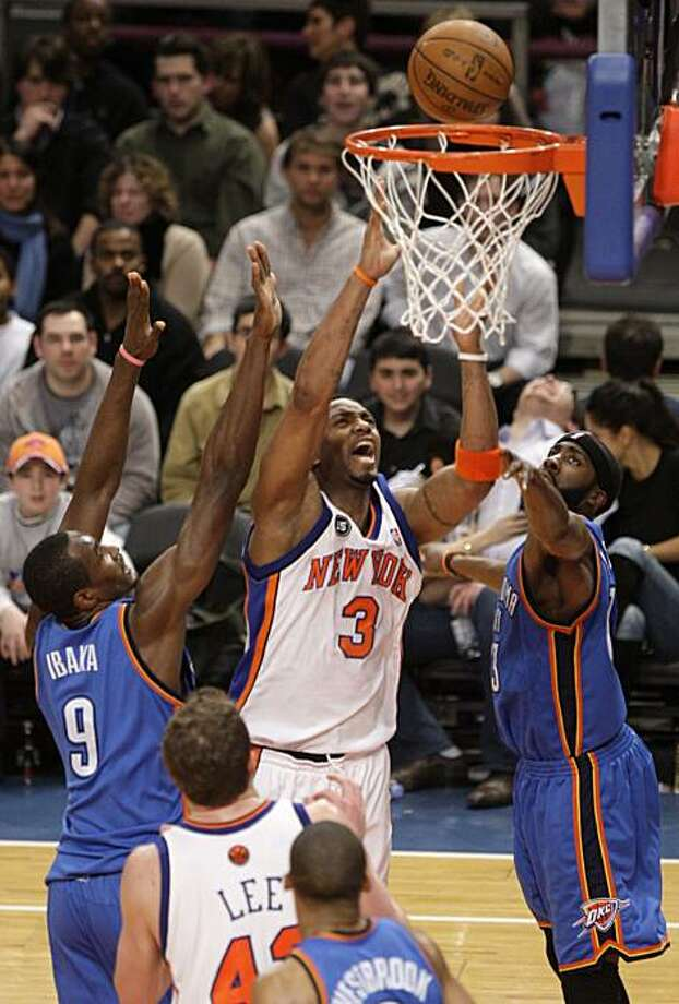 New York Knicks' Tracy McGrady (3) drives past Oklahoma City Thunder's Serge Ibaka, left, and teammate James Harden, right, during the first half of an NBA basketball game  Saturday, Feb. 20, 2010  in New York. Photo: Frank Franklin II, AP