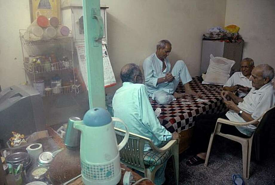 At Gharaunda, an old age home for elders, the men gather every day after lunch to play cards for several hours to while away the time. Gharaunda is a charitable old age home, one of the few that accept both men and women. Photo: Bishan Samaddar