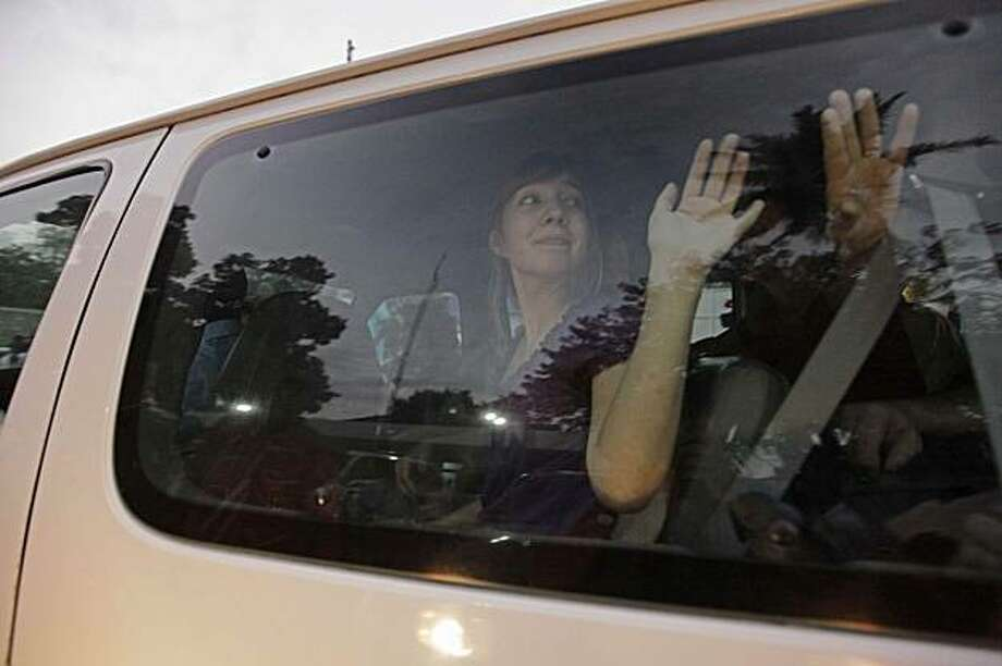 Nicole Lanford, 18, of Meridian, Idaho, one of the American missionaries charged with child kidnapping waves as she is driven away on a van from a Haitian jail in Port-au-Prince, Wednesday Feb. 17, 2010. Eight of the ten U.S. missionaries arrested were released on Feb. 17, nearly three weeks after they were caught trying to take a group of children out of the quake stricken country. Photo: Ramon Espinosa, AP