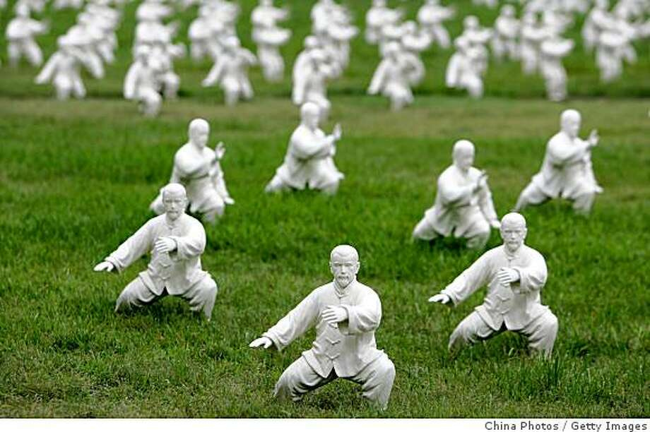 BEIJING, CHINA - AUGUST 1: (CHINA OUT) Sculptures of people performing Tai Chi are displayed at Peking University on August 1, 2008 in Beijing, China. A total of 600 sculptures have been placed on the campus to usher in the Olympic Games. Peking University Gymnasium is the table tennis venue for the 2008 Beijing Olympics. Photo: China Photos, Getty Images