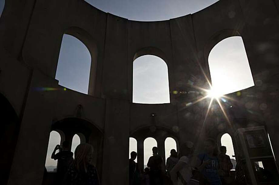 Tourists enjoy the view from atop Coit Tower on February 17, 2010 in San Francisco, California. Photograph by David Paul Morris / Special To The Chronicle Photo: David Paul Morris, The Chronicle
