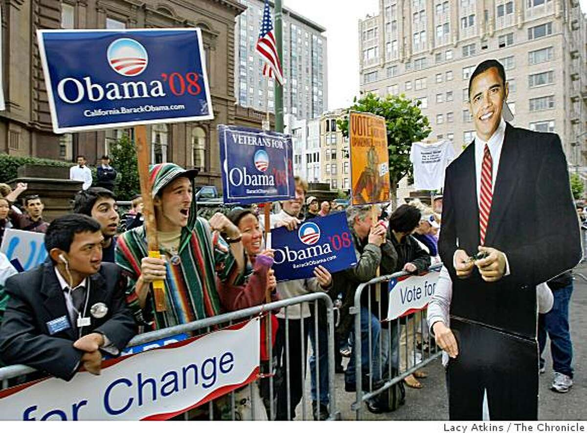 Supporters cheer as a cut out of Democratic President candidate Barack Obama is carried by Ame Szasz in front of the Fairmont Hotel where Obama is attending a fundrasier, Sunday Aug. 17, 2008, in San Francisco, Calif.