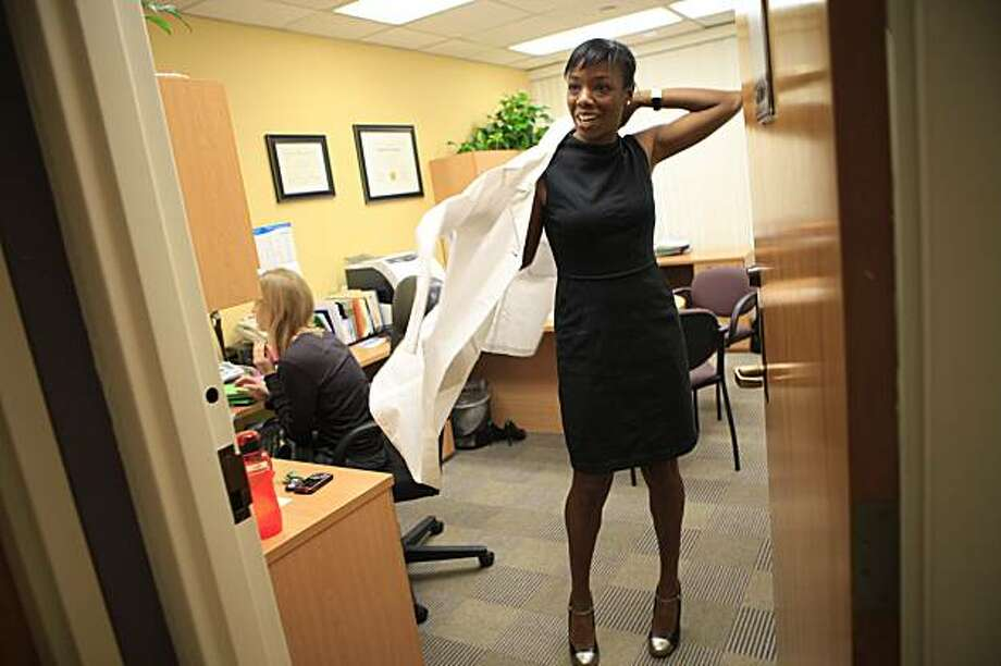 After an off-site meeting, Dr. Nadine Burke, of the Bayview Child Health Center, puts on her white jacket before seeing patients at the Bayview Child Health Center on Thursday February 4, 2010 in San Francisco, Calif. Photo: Lea Suzuki, The Chronicle