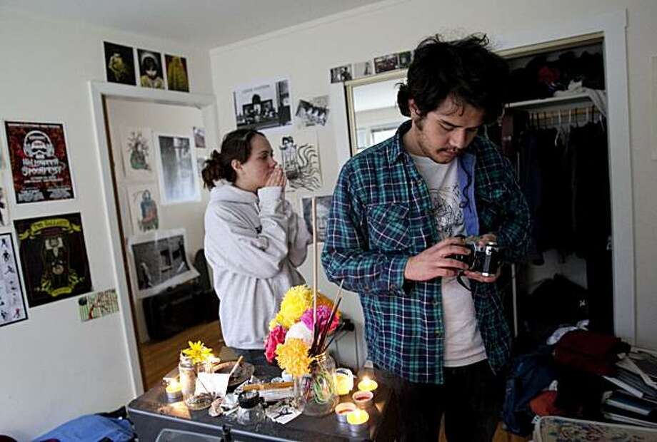 Victor Prieto looks at his twin brother's camera in the room they shared together before Luis Armando Prieto was struck and killed early Friday morning by a car fleeing a shooting outside a strip club in San Francisco. Photo: Laura Morton, Special To The Chronicle