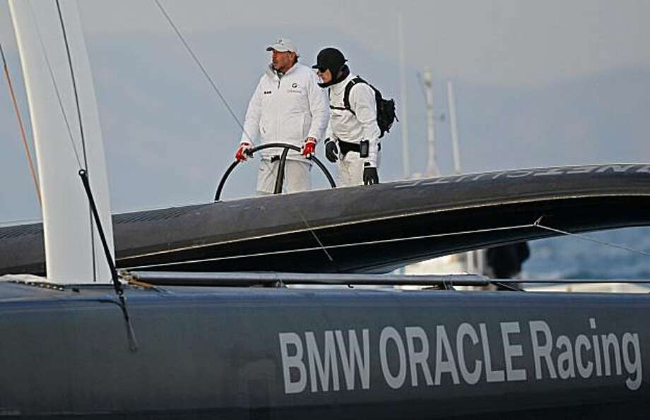 American BMW Oracle owner Larry Ellison, left, and helmsman's James Spithill, right, sail their BOR 90 boat back to port after defeating Swiss defender Alinghi 5 on the first race of the 33rd America's Cup in Valencia, Spain, on Friday, Feb. 12, 2010. Photo: Victor R. Caivano, AP