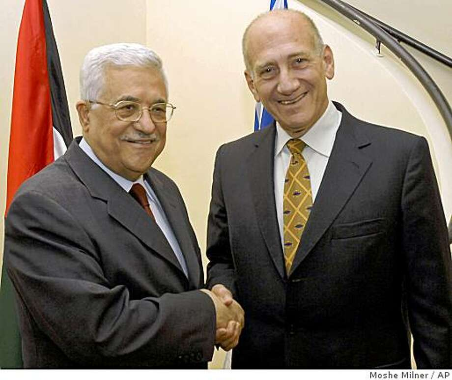 In this photo released by the Israeli Government Press Office, Israel's Prime Minister Ehud Olmert, right, and Palestinian President Mahmoud Abbas, left, meet in Jerusalem, Wednesday, Aug. 6, 2008. The meeting between Olmert and Abbas was the first since Olmert announced he would step down after his party selects a new leader in September. (AP Photo/ GPO, Moshe Milner, HO) **  ISRAEL OUT  ** Photo: Moshe Milner, AP
