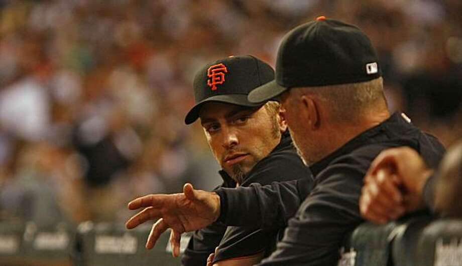 Giants pitcher Jeremy Affeldt talks to a coach while he waits in the dugout during the game against San Diego Padres,  Tuesday April 21, 2009, in San Francisco, Calif. Photo: Lacy Atkins, The Chronicle