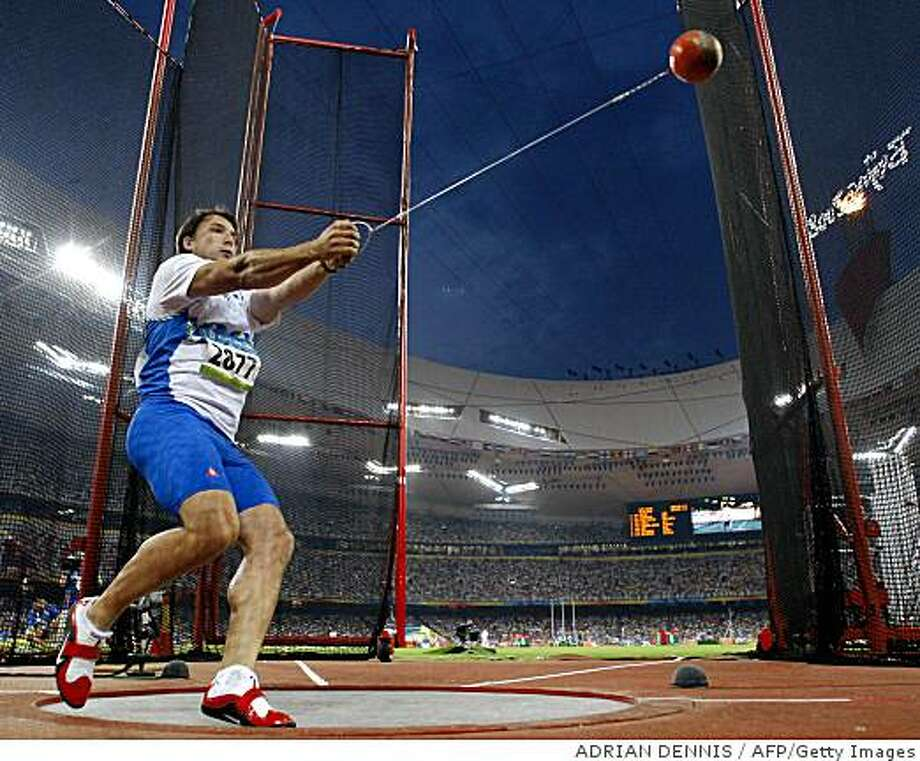 Slovakia's Primoz Kozmus competes during the men's hammer throw final at the National Stadium as part of the 2008 Beijing Olympic Games on August 17, 2008.  Primoz Kozmus of Slovenia won the men's hammer gold medal at the Olympics today.   AFP PHOTO / ADRIAN DENNIS (Photo credit should read ADRIAN DENNIS/AFP/Getty Images) Photo: ADRIAN DENNIS, AFP/Getty Images