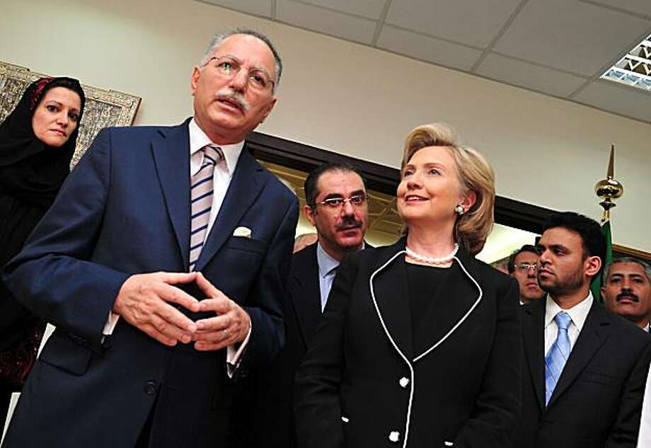 """US Secretary of State Hillary Clinton (R) listens to the head of the Organisation of the Islamic Conference (OIC), Ekmeleddin Ihsanoglu, as he briefs the press in the Saudi coastal city of Jeddah on February 16, 2010. Saudi Arabia said it prefers an """"immediate resolution"""" to the crisis over Iran's nuclear programme rather than sanctions, as Clinton prepared to wrap up her Gulf tour. Photo: Amer Hilabi, AFP/Getty Images"""