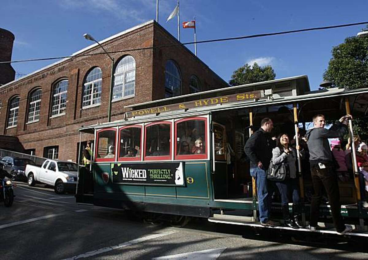 The Cable Car Museum at Washington and Mason streets as a passenger filled trolley passes by in San Francisco, Ca., on Tuesday, February 9, 2010.