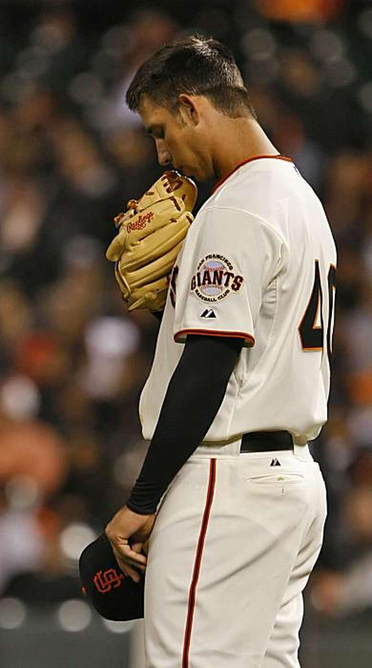 The San Francisco Giants pitcher Madison Bumgarner bows his head at the start of each inning as he pitches against the San Diego Padres Tuesday Sept. 8, 2009, in San Francisco, Calif.