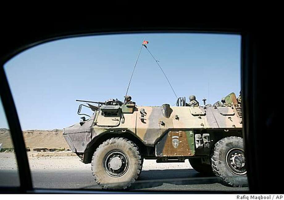 An armoured vehicle of French troops patrol  in Surobi, Afghanistan, Tuesday, Aug. 19, 2008. About 100 insurgents ambushed a group of French paratroopers outside Kabul, sparking a battle that killed 10 of the soldiers in the biggest loss of life for international forces in combat in Afghanistan in more than three years, officials said Tuesday. French President Nicolas Sarkozy announced that he would immediately fly to Kabul. (AP Photo/Rafiq Maqbool) Photo: Rafiq Maqbool, AP