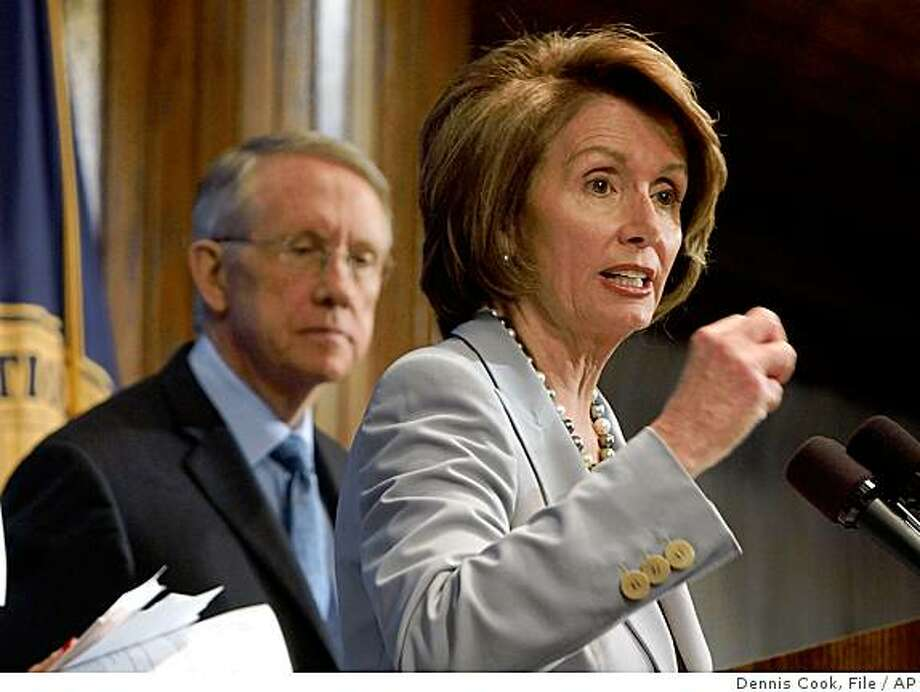 "** FILE ** In this Jan. 25, 2008, file photo, House Speaker Nancy Pelosi, right, accompanied by Senate Majority Leader Harry Reid discuss ""the State of Our Union,"" at the National Press Club in Washington. They did not end the Iraq war or tackle $4-a-gallon gas. But the Democratic-run Congress created programs this year to educate veterans and feed and house the poor. Democrats also cuts deals with a weakened GOP president to send voters some economic help.  (AP Photo/Dennis Cook) Photo: Dennis Cook, File, AP"