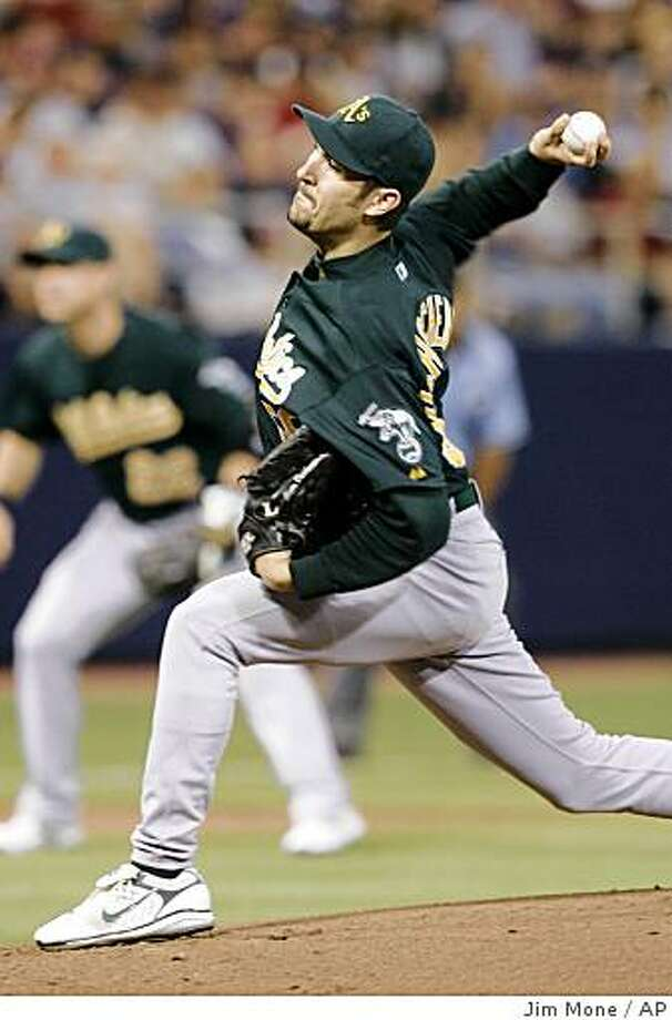 Oakland Athletics' Justin Duchscherer delivers a pitch against the Minnesota Twins in the first  inning of a baseball game Monday, Aug. 18, 2008 in Minneapolis. (AP Photo/Jim Mone) Photo: Jim Mone, AP
