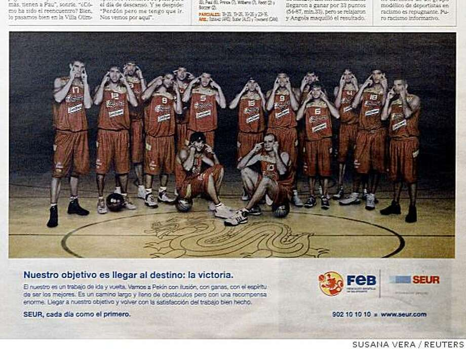 The Spanish basketball team appears in an advertisement in the Spanish sports newspaper Marca August 13, 2008 showing the players making slit-eyed gestures. Spanish basketball player Jose Calderon rejected international media accusations on Wednesday that slit-eyed gestures by his team at the Beijing Olympics were racist and said he had great respect for Asian people. REUTERS/Susana Vera (SPAIN) Photo: SUSANA VERA, REUTERS