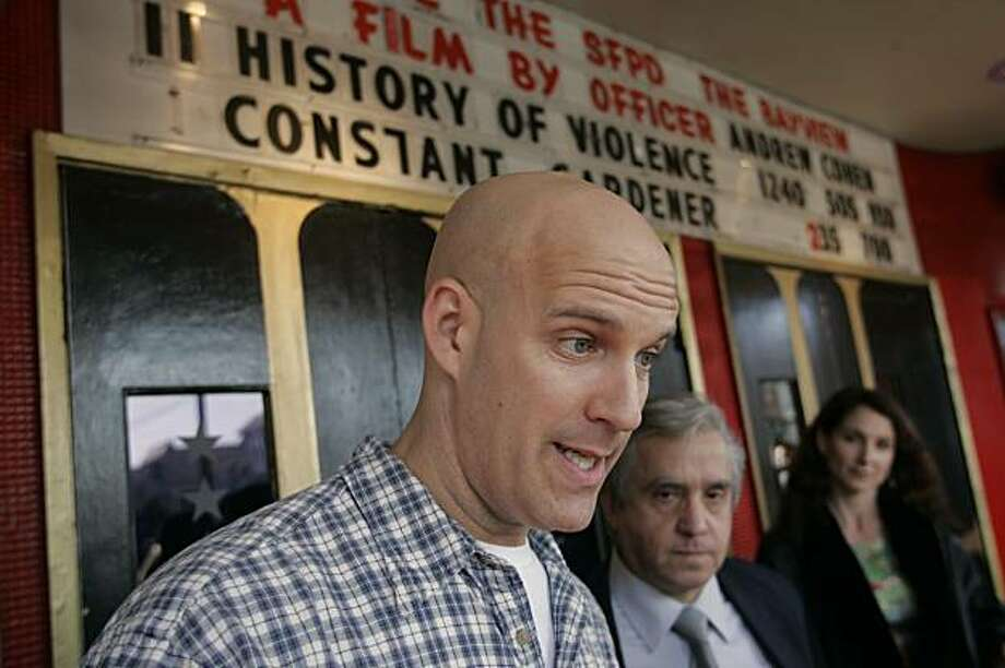 "SFPD Officer Andrew Cohen (left) speaks to the media outside the Four Star Theater where Cohen's video epic ""Inside the SFPD - the Bayview"" premiered.  Standing with him are David Heller, president of the Greater Geary Boulevard Merchants and Property Owners Association and Cohen's fiance' Wendy Hurley. The Four Star Theater is located at 2200 Clement Street in the Richmond District. Photo: Chris Stewart, The Chronicle"