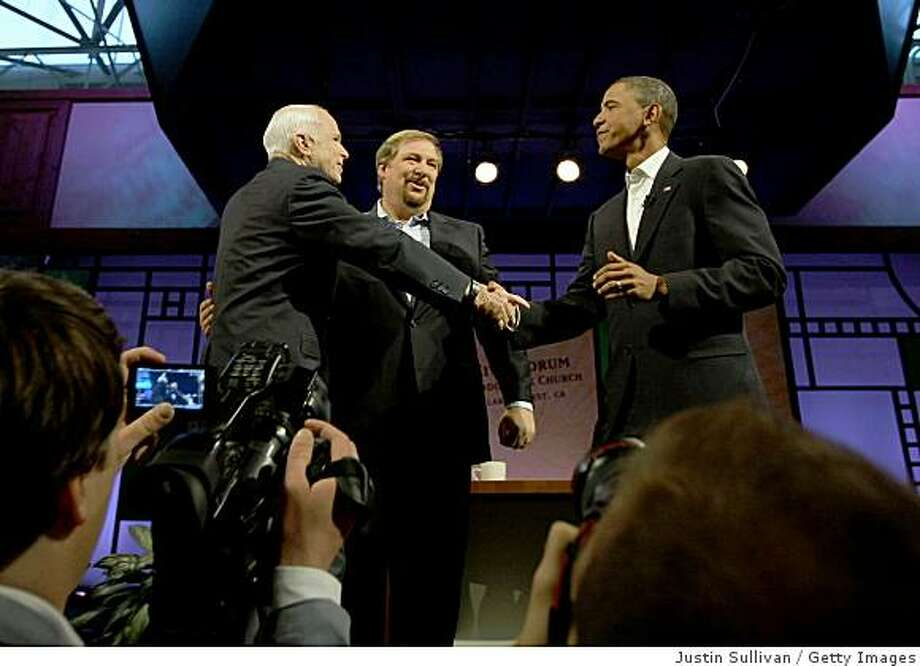 LAKE FOREST, CA - AUGUST 16:  (L-R) Presumptive Republican Presidential candidate U.S. Sen. John McCain (R-AZ), pastor Rick Warren and Presumptive Democratic Presidential candidate U.S. Sen. Barack Obama (D-IL) greet each other before the start of the Civil Forum on the Presidency at the Saddleback Church August 16, 2008 in Lake Forest, California. Obama and McCain participated in a town hall style meeting moderated by the Saddleback Church pastor Rick Warren.  (Photo by Justin Sullivan/Getty Images) Photo: Getty Images