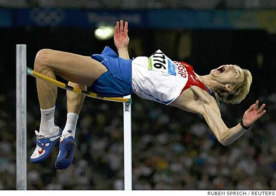 Andrey Silnov of Russia competes in his men's high jump final of the athletics competition in the National Stadium at the Beijing 2008 Olympic Games August 19, 2008.     REUTERS/Ruben Sprich (CHINA) Photo: RUBEN SPRICH, REUTERS