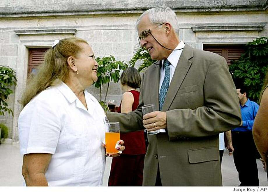 **APN ADVANCE FOR SUNDAY AUG.17** ** FILE ** In this Dec. 10, 2005 file photo, Michael Parmly, the chief of the U.S. Interests Section, right, speaks with political activist Laura Pollan during the celebration of International Human Rights Day at his residence in Havana. (AP Photo/Jorge Rey, File) Photo: Jorge Rey, AP
