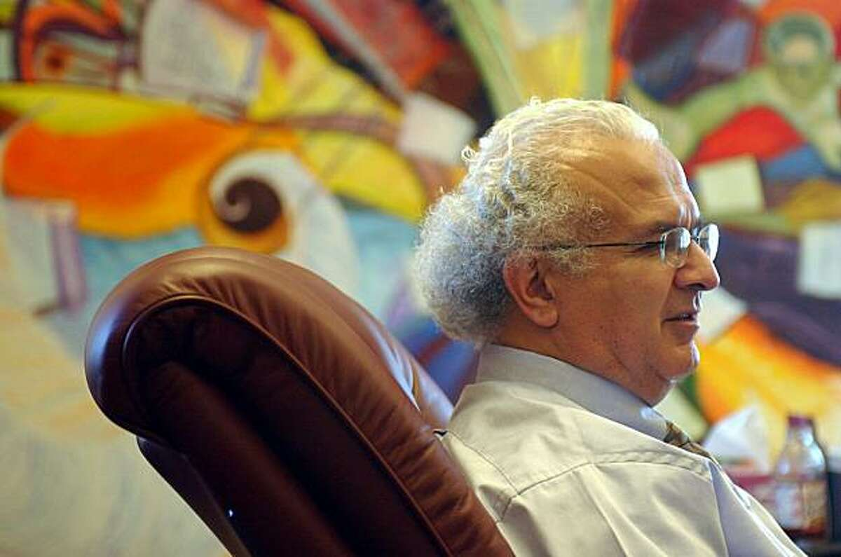 California Supreme Court Justice Carlos Moreno is seen in his office in downtown San Francisco on Tuesday, Oct. 14, 2003. A painting entitled