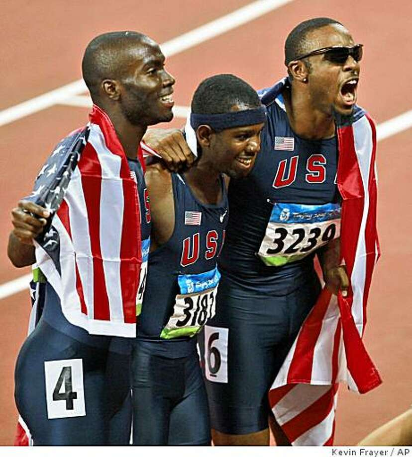 United States', from left, Kerron Clement, silver, Bershawn Jackson, bronze, and Angelo Taylor, gold, celebrate after the men's 400-meter hurdles final during the athletics competitions in the National Stadium  at the Beijing 2008 Olympics in Beijing, Monday, Aug. 18, 2008.(AP Photo/Kevin Frayer) Photo: Kevin Frayer, AP