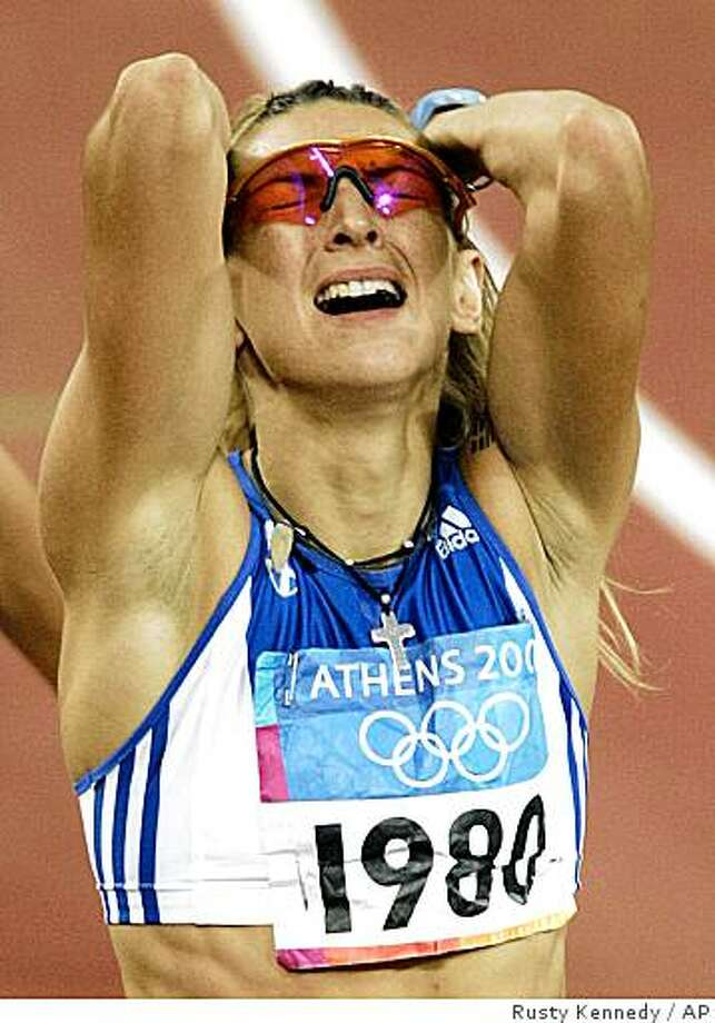 In this file photo dated Aug. 25, 2004, Fani Halkia of Greece reacts after winning the gold medal in the 400-meter hurdles with a time of 52.82 seconds during the 2004 Athens Olympic Games in Athens, Greece. Halkia tested positive for a banned substance, the Greek TV station Skai TV reported Saturday. Photo: Rusty Kennedy, AP