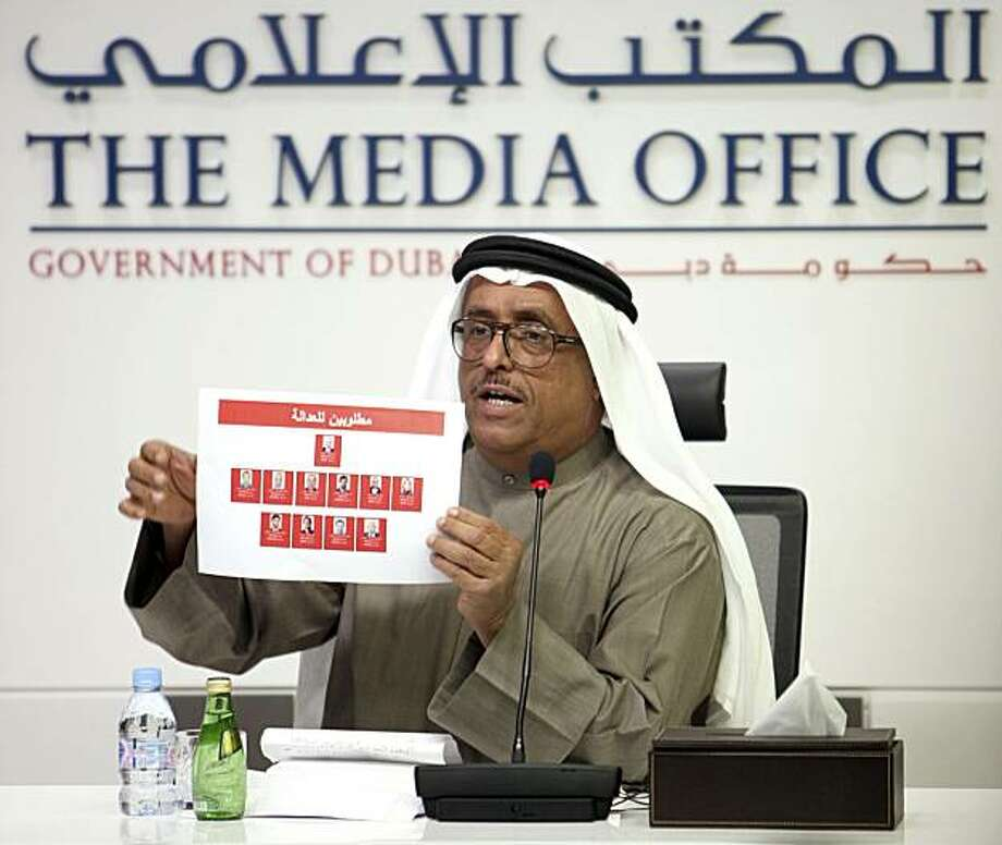 This photo released by the Dubai Ruler's Media Office on Monday, Feb. 15, 2010, shows Dubai's Police Chief Lt. Gen. Dhahi Khalfan Tamim identifying eleven suspects wanted in connection with the killing of a Hamas commander, Mahmoud al-Mabhouh, in his Dubai hotel room last month, at a press conference in Dubai, United Arab Emirates Monday, Feb. 15, 2010. (AP Photo/Dubai Ruler's Media Office) EDITORIAL USE ONLY Photo: AP