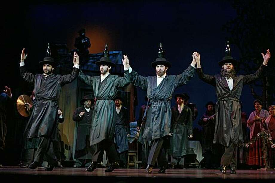 Matthew Rossoff, Matthew Kilgore, Robbie Roby, Rick Pessagno & the Company in a scene from the famed bottle dance in Fiddler on the Roof, now playing at best of broadway   Photo by Joan Marcus Photo: Joan Marcus