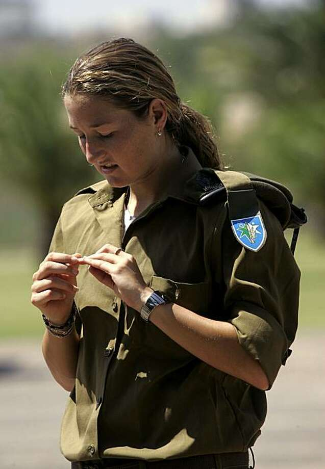 Israeli tennis player Shahar Peer stands in her army uniform after a training session in Tel Aviv, Israel, Monday Sept. 17, 2007. Until recently, Shahar Peer was playing in the quarterfinals of the U.S. Open in New York. Today, the world's No. 16 female tennis player is back in Israel, wearing an olive green military uniform. Photo: Ariel Schalit, AP