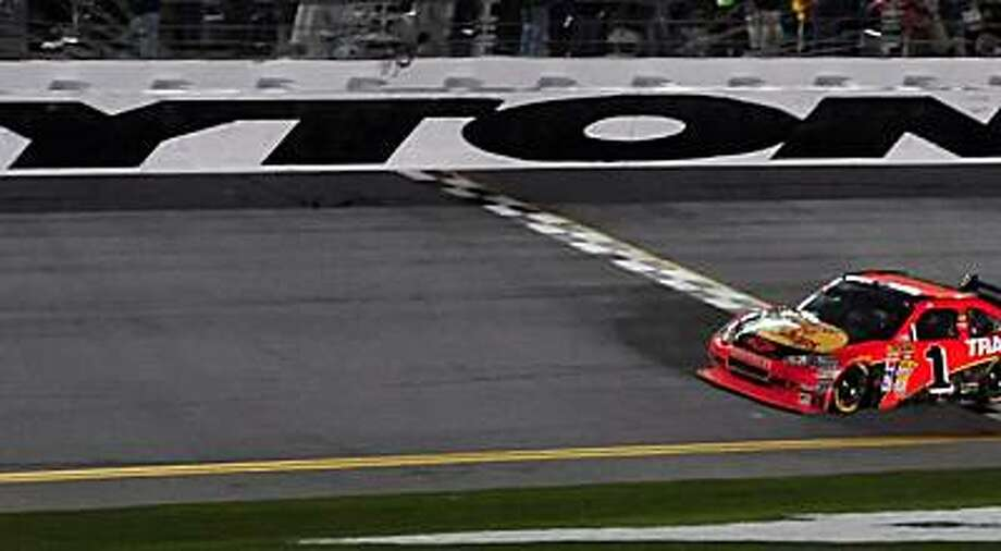 NASCAR Sprint Cup Series driver Jamie McMurray (1) crosses the start/finish line to win the Daytona 500 Sunday at Daytona International Speedway in Daytona Beach, Florida, Sunday, February 14, 2010. (Jeff Siner/Charlotte Observer/MCT) Photo: Jeff Siner, MCT