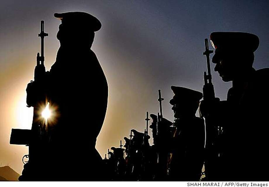 Afghan guard of honor stand in a attention during a ceremony marking the anniversary of Afghanistan's independence Day in Kabul on August 18, 2008. A suicide car bomb blew up on August 18 outside a US military base in eastern Afghanistan, killing nine civilian labourers, as the country marked Independence Day under the shadow of extremist attacks. AFP PHOTO/SHAH Marai (Photo credit should read SHAH MARAI/AFP/Getty Images) Photo: SHAH MARAI, AFP/Getty Images