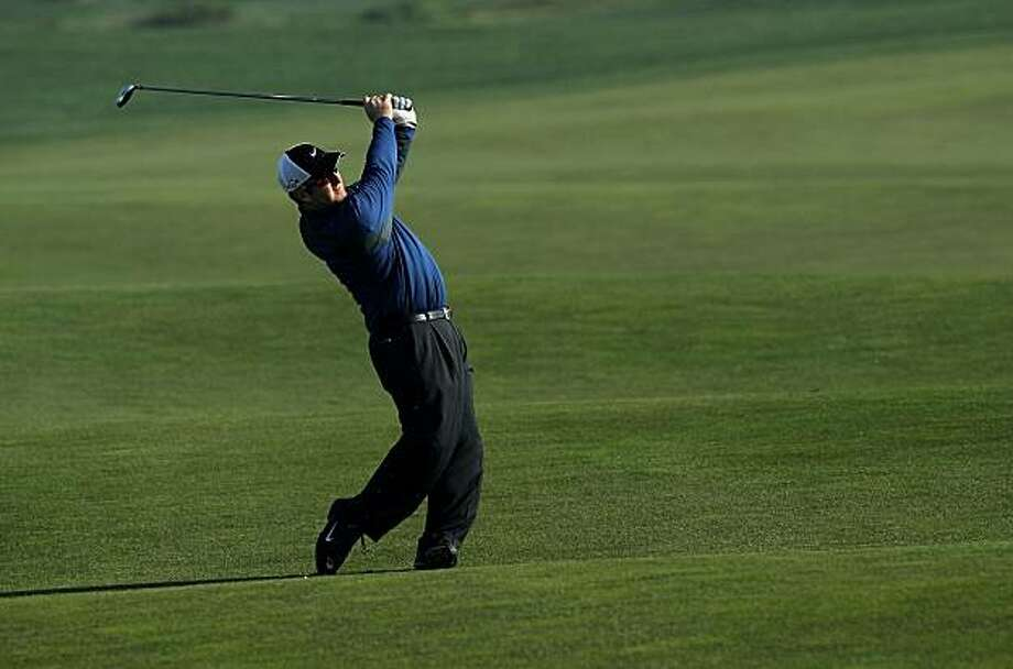 PEBBLE BEACH, CA - FEBRUARY 13:  David Duval hits his second shot on the 10th hole during the third round of the AT&T Pebble Beach National Pro-Am at Monterey Peninsula Country Club on February 13, 2010 in Pebble Beach, California. Photo: Stephen Dunn, Getty Images