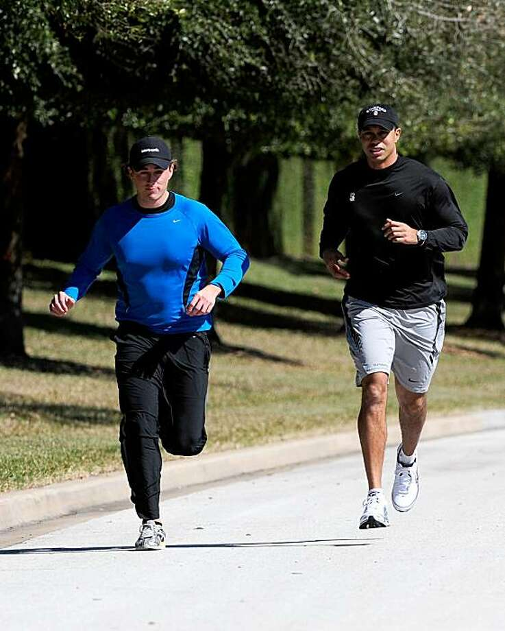 Tiger Woods (right) jogs with an unidentified friend near his home on February 17th in Orlando, Florida. Photo: Sam Greenwood, Getty Images