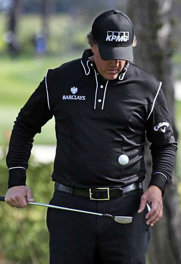 Phil Mickelson bounces his ball while waiting for his foursome to arrive at the sixteenth green at Pebble Beach Golf Links during the Third round of the AT&T Pebble Beach National Pro-Am golf tournament in Pebble Beach, Calif. Saturday, Feb. 13, 2010. Photo: Lance Iversen, The Chronicle
