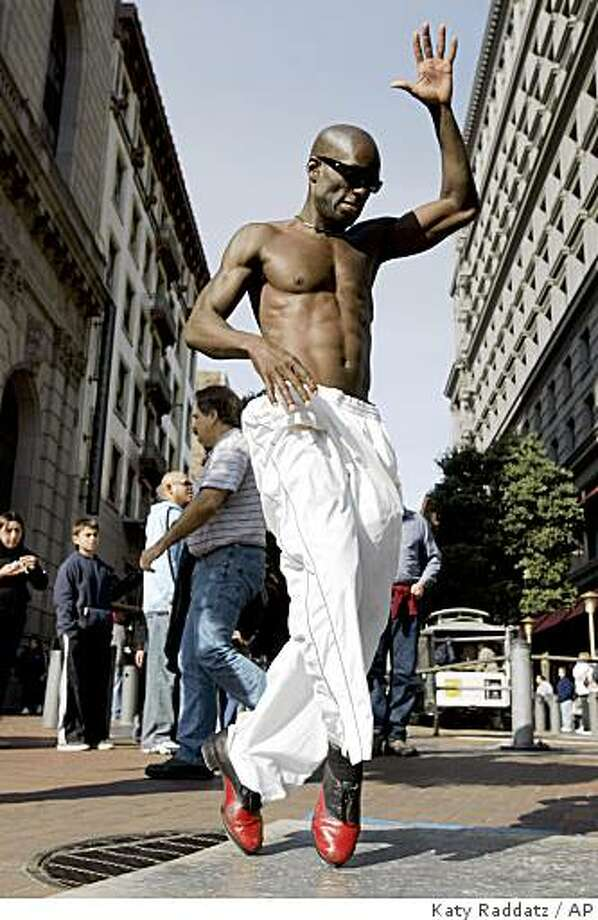 Tap dancer Edward Jackson has returned to San Francisco. He dances in the street, usually at the Powell Street cablecar turntable. This photo shows him at that location in 2007. Photo: Katy Raddatz, AP