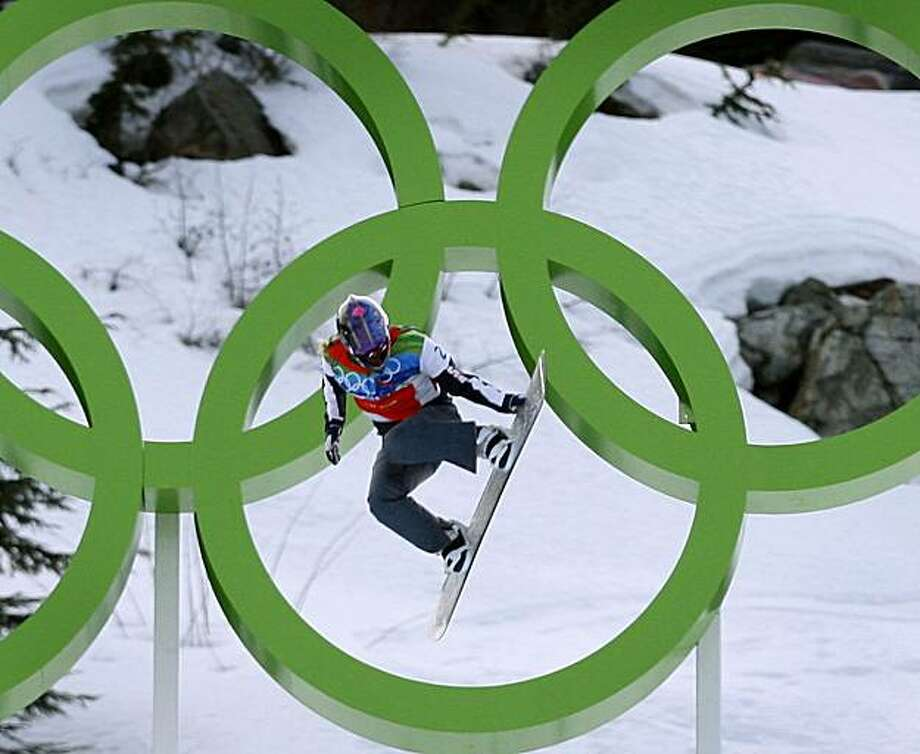 Lindsey Jacobellis of the United States grabs her board on a jump in the semifinal round of the women's snowboard cross competition in the Winter Olympic Games at Cypress Mountain in West Vancouver, British Columbia, on Tuesday. Photo: Paul Chinn, The Chronicle