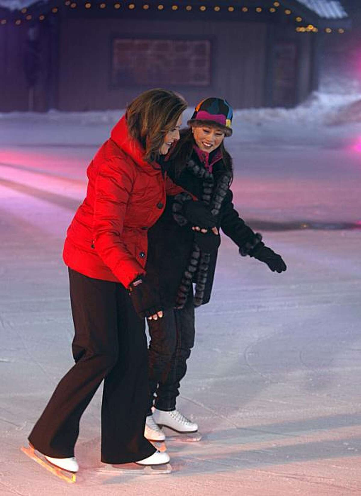 Figure skater Kristi Yamaguchi (right) helps co-host Meredith Vieira skate on the ice during an appearance on the Today show broadcast from Grouse Mountain ski area in North Vancouver, B.C., on Friday, Feb. 12, 2010. Yamaguchi won a gold medal at the 1992 Winter Olympic Games at Albertville, France.