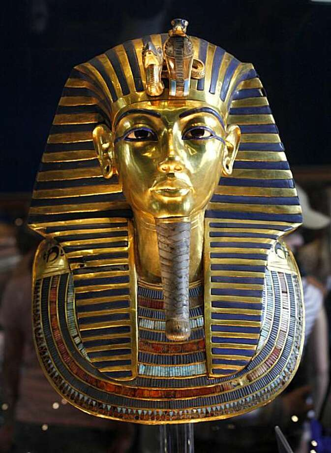 In this Feb. 15, 2010 photo, the golden mask of Egypt's famous King Tutankhamun is displayed at the Egyptian museum in Cairo, Egypt. Egypt's famed King Tutankhamun suffered from a cleft palate and club foot, likely forcing him to walk with a cane, and died from complications from a broken leg exacerbated by malaria, according to the most extensive study ever of his mummy. Photo: Amr Nabil, AP